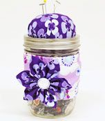 Project: Mason Jar Sewing Kit - great place to keep those odd buttons also.  (personally, I prob drop the flower decor and change color scheme)