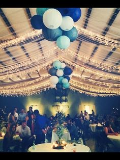 7 ways to save money on reception rentals ceilings church wedding wedding reception tulle and gathered lanterns in blue for a winter wedding junglespirit Gallery