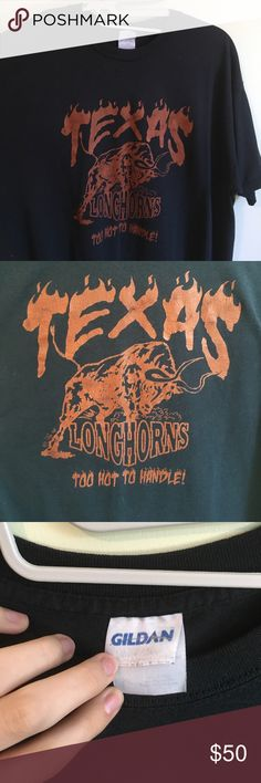 """90's vintage UT longhorns Tee Vintage 90's UT longhorns tee. Has a sassy """"too hot to handle"""" saying on it. The shirt was probably originally black but because it's a true vintage item it's now a beautiful worn in grey color. The design on the shirt has that crack vintage look-- but it's still in good enough condition that it won't come off in a couple of years. In a size XL. This is a one of a kind vintage item! Vintage Tops Tees - Short Sleeve"""