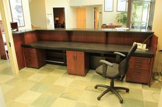 Custom Made Zodiac and Walnut Reception Desk