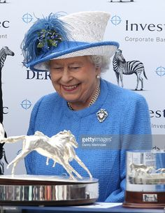 Queen Elizabeth II gives the prize to the Epsom Derby winning trainer Dermot K. Weld at the Epsom Derby at Epsom Racecourse on June 4, 2016 in Epsom, England.