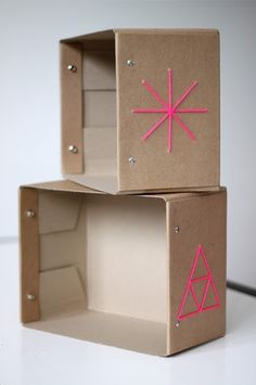cardboard boxes and neon pink detail