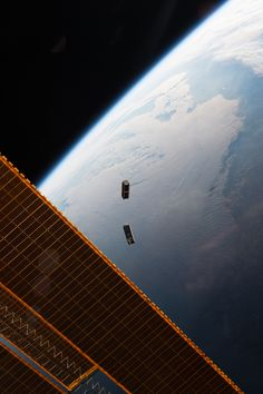 Picture of the day for May 20 2016 by Nasa CubeSats fly free after leaving the NanoRacks CubeSat Deployer on the International Space Station on May 17 2016. Seen here are two Dove satellites. The satellites are part of a constellation designed built and operated by Planet Labs Inc. to take images of Earth from space.
