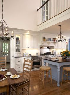 love the white cabinets and colored island