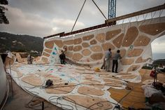 Raising the second layer, with plywood window forms, that will be draped over the first.
