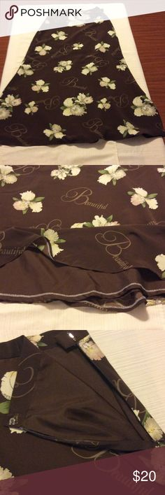 """Handmade Brown long skirt with tan floral pattern Beautiful and elegant long skirt, great for the coming winter. Has the word beautiful in long script. Length is 34.5"""", waist is 24"""", and the hips is 34"""". Skirts A-Line or Full"""