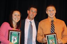 Alumni Eileen Davidson and Kyle Bond receive Hall of Fame Awards from Athletics Director Jeff Gates.