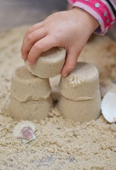 STICKY SAND Recipe- this stuff is lots of fun for kids to play with. It acts like wet sand but isn't actually wet. It sticks together well, creating the perfect mold-able sand for sculpting and creating. Sticky sand also vacuums up easily, making it great for both indoor and outdoor use.