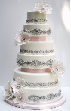 Stunning vanilla buttercream cake with edible silver detail and pink ribbons, very luxurious! Enjoy RUSHWORLD boards, WEDDING CAKES WE DO, WEDDING GOWN HOUND and UNPREDICTABLE WOMEN HAUTE COUTURE. Follow RUSHWORLD! We're on the hunt for everything you'll love!