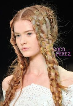 Really cool braids and such a soft face- Alexander McQueen show in Paris in 2011