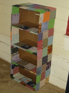 Recycled Fabric-Covered Cardboard Box Shelf. I've been doing this for months, and it's awesome. I have made a book box for my son's books as well as a couple boxes to hold all his toys in :)