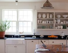 I love white cabinets, especially with dark countertops. The sink and the butcher block island are also musts.