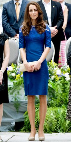 Catherine Middleton wearing an embroidered Erdem sheath with patent leather pumps and a tan envelope clutch.