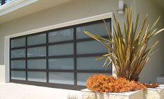 Athena all glass garage doors are beautiful modern garage doors that are the ultimate choice to modernize any home. House Design, Modern Garage Doors, Garage, Garage Doors, Modern, Ranch Style Homes, Doors, Garage Door Types, House Exterior