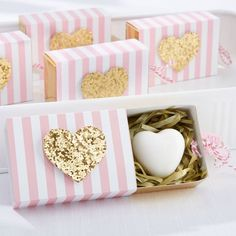 """Pre-packed in a pink and white striped box with gold foil and a twine pull, these """"heart of gold"""" soap favors are thoughtful way to thank your bridal shower or wedding guests for attending."""