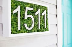 DIY House Number Displays That Will Instantly Up Your Curb Appeal Go green with a swatch of faux grass encased in wood. Get the tutorial at A Beautiful Mess. - Go green with a swatch of faux grass encased in wood. Get the tutorial at A Beautiful Mess. Porta Diy, Green Front Doors, Faux Grass, Eco Friendly Cleaning Products, How To Make Diy, Beautiful Mess, House Numbers, Entry Doors, Decoration