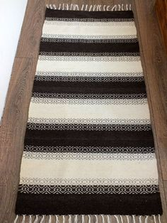 """A wool rug with a beautiful """"filigree"""" accent spanning the """"seam"""" where the blocks abruptly change color.  Very nicely designed!"""