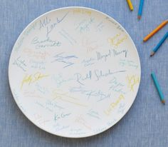 Have guests sign a plate/platter and then glaze it for future use for parties
