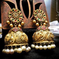 Looking for South Indian Gold Jhumka Designs? Here are our picks of 21 beautiful jhumka models that would look good on anyone and on every dress. Indian Wedding Jewelry, Bridal Jewelry, Gold Jewelry, Craft Jewelry, Diamond Jewellery, Indian Weddings, Indian Bridal, Custom Jewelry, Jhumka Designs
