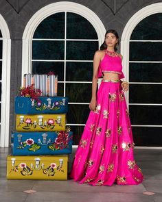 Featuring a hot pink matka silk lehenga embellished with gold custom cut sequined butterfly scatter paired with a matching ruffled crop top and a gold leather belt. Fabric: Matka Silk Care: Dry Clean Only Blouse Back Neck Designs, Lehenga Designs, Saree Blouse Designs, Sari Blouse, Peplum Blouse, Blouse Styles, Lehenga Choli Online, Dhoti Saree, Sarees