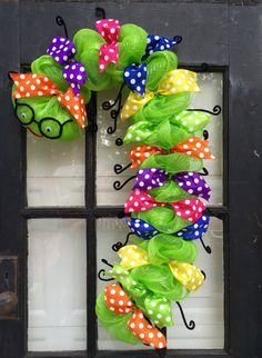 Back to school time is right around the corner and this bookworm wreath is the perfect back to school wreath, back to school decoration, gift for teacher, etc.... This cute bookworm measures 31 long X 18 wide. Made with lime green deco mesh. Decorated with multiple color polka dot wired ribbon, cute little black glasses and legs made out of black fuzzy sticks, and a red smile on its face. This adorable bookworm wreath is a great decoration to welcome the kids back to class, a great gift for…