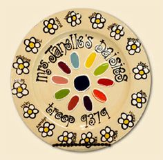 Girl Scout troop - daisies  Might have to do this at our Pottery Painting party next month!