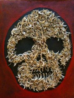 This image was found on My Life As A Zombie. There was no crediting so I'm unsure who the original creator was. This fingernail clippings skull was also also featured on the TV series 'Oddities'.