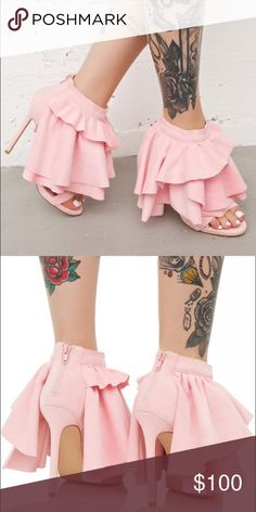 Privileged Baby Pink Ruffle Pumps Coming Soon These amazing heels feature a smoooth baby pink vegan suede construction, sky high heels, open toe, tiered voluminous ruffles cascading down from the ankle, and zip back closure. Nasty Gal Shoes Heels