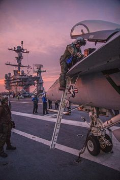 SOUTH CHINA SEA (June 14, 2014) Capt. William Koyama, commander, Carrier Air Wing (CVW) 5, debarks an F/A-18E Super Hornet from the Dambusters of Strike Fighter Squadron (VFA) 195 after making his 1000th career arrested landing on the flight deck of the Nimitz-class aircraft carrier USS George Washington (CVN 73). (U.S. Navy photo by Mass Communication Specialist 1st Class Trevor Welsh/Released)