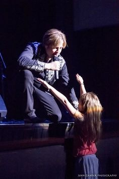 Downey theatre - Easter Seals benefit concert / Ricky Nelson Remembered / Matthew Nelson hugs a young fan Photo by John Zander