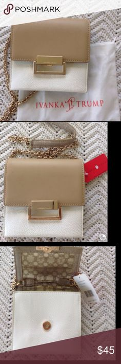 Pretty Ivanka Trump Cross Body Purse NWT This is a super nice bag. It does have some very small smudge scratches on the name tag on front, but is not that noticeable. It has the chain strap that is very nice. It is made nicely and to last.. It does include the dust bag. Ivanka Trump Bags Crossbody Bags