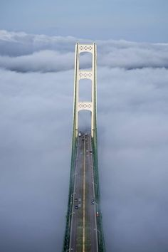 Mackinac Bridge shot from the South Tower, looking at the North Tower in the directon of St. Ignace with heavy fog washing over the bridge deck. Michigan Travel, State Of Michigan, Detroit Michigan, Northern Michigan, Lake Michigan, Wisconsin, Mackinaw City, Mackinac Bridge, Upper Peninsula