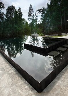 Black Zero Edge Swimming Pool....Oh Black water......Perfect for a Midnight swim. Beautiful sky reflections on a Black pool. Modern Pool. Modern Architecture.