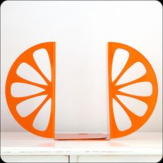Bookends - Orange - laser cut for precision these metal bookends will hold your favorite cookbooks or books. €34.00, via Etsy.