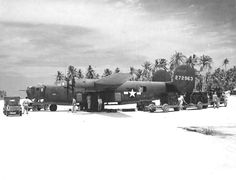 B-24D Liberator of the 42nd Bomb Squadron being loaded with fragmentation bombs at Funafuti, Gilbert Islands, Nov 18 1943.