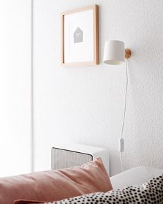 Livingroom Details: Wall Lamp, House Illustration and some pillows.