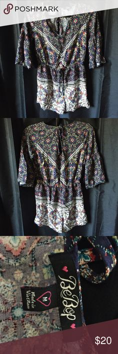 🔴Boho chic romper This boho chic romper is perfect for a vacation getaway. No tops or bottoms, just pull on and it's one and done! Print is still bright as ever, but there is some damage on the neckline. (See picture). Nothing a budding seamstress can't fix. Nordstrom Rack Pants Jumpsuits & Rompers