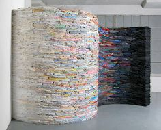 New York artist, curator and co-founder of TAG Projects, Derick Melander, meticulously folds and strategically stacks thousands of pounds of second hand t-shirts into social conscious sculptures.