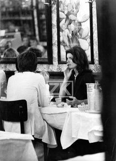 Jackie in a Paris restaurant, 1970's.