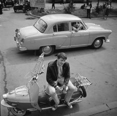 Soviet young man on a scooter. Wearing either Keds or counterfeit Chucks.