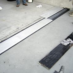 U of Georgia Replaces Noisy Leaking Stadium Concourse Expansion Joint Cover Plates with Non-Invasively Anchored SJS SYSTEM expansion joint from EMSEAL