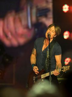 Keith Urban, four-time Grammy Award winner and American Idol judge, performs at the Thompson-Boling Arena in Knoxville on Friday, Jan. 31, 2...