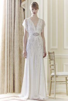 "Brides.com: Great Gatsby-Inspired Wedding Dresses. ""Florence"" v-neck beaded sheath wedding dress with sheer short sleeves and crystal embellished belt, Jenny Packham."