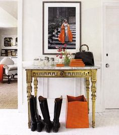 lovely use of a very small area - love the  smart use of orange, black and antique gold… it creates a goof focal point between two doors, slows and ground the energy. nice!