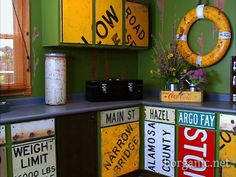 old metal signs as cabinet fronts