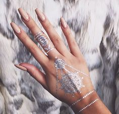 Nude long nails, tattoo