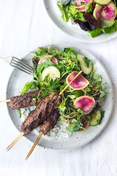 Middle Eastern-spiced Lamb Kebabs with a Tangy Herb Salad and Dilled Yogurt Sauce. A light and healthy, paleo friendly dinner that is bursting with flavor! Healthy Dinner Recipes, Whole Food Recipes, Healthy Dinners, Nutritious Meals, Lunch Recipes, Yummy Recipes, Healthy Food, Grilling Recipes, Cooking Recipes