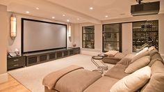 entertainment room: big tv & couch & wine in the walls