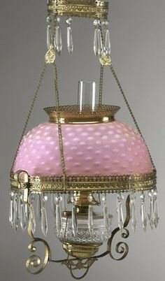 lighting, Victorian pull-down chandelier [or hanging lamp], complete with pink hobnail shade, pendants and chimney. Circa 1876-1900