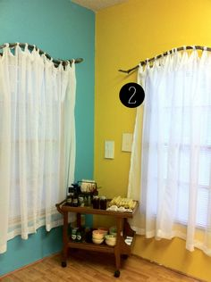 Branches for curtain rods - neat idea. But not with those colors.